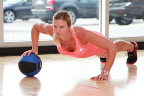 Danica performing single arm medicine ball push-ups at LA Fitness - 2