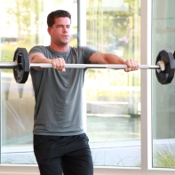 a shoulder front raise with barbell at LA Fitness 3