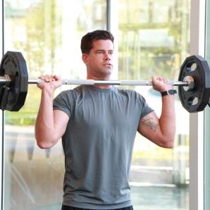 a shoulder press with barbell at LA Fitness 1
