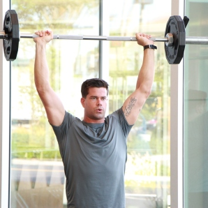a shoulder press with barbell at LA Fitness 2