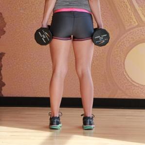Bethany-doing-dumbbell-calf-raise-at-LA-Fitness