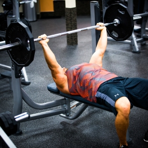 Bench press barbell at LA Fitness with Derek-8